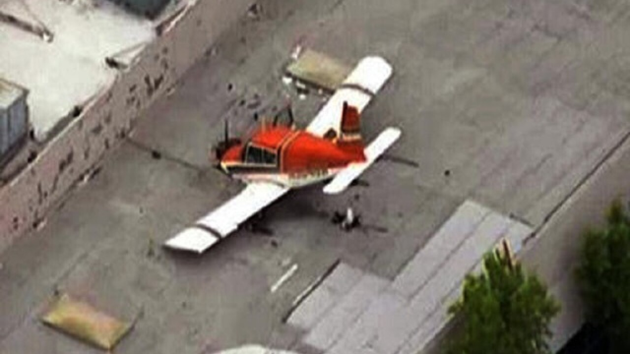 Small plane crashes onto California building's roof