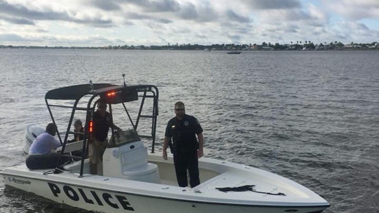 Stuart officers rescue couple who fell overboard, police say