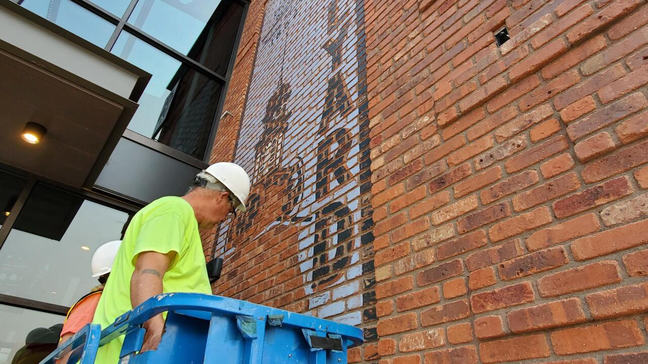 Walldogs paint ghost sign in new Helena bank
