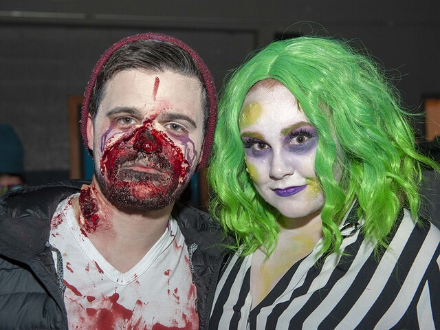 Go-go dancers, cavemen and supervillains party at Rhinegeist Halloween bash