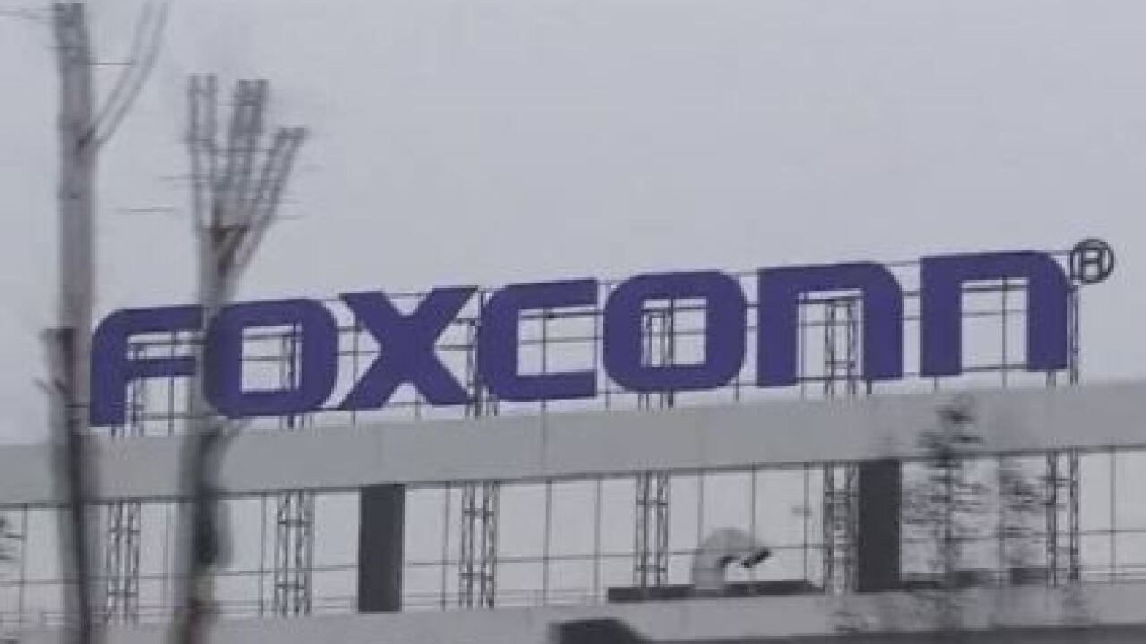 Tony Evers, Foxconn say Wisconsin project moving forward.