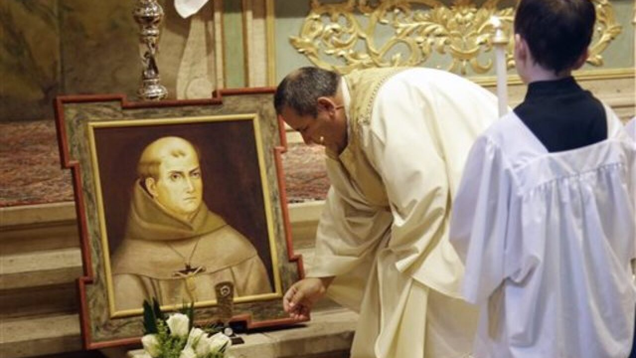 Vandals strike mission after Serra canonized