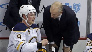 Sabres head coach Ralph Krueger chats with Jack Eichel