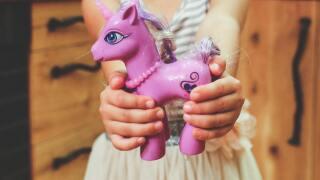 child-holding-unicorn-toy-6191.jpg