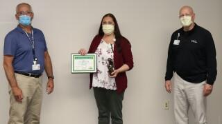 Sara Hagerman receives Daisy Nursing Award from Monte Malek and Mark Brisboe