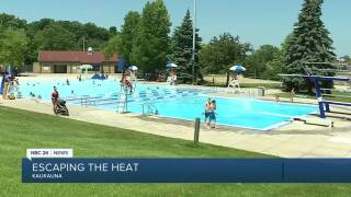 Local pools open with new restrictions.jpg