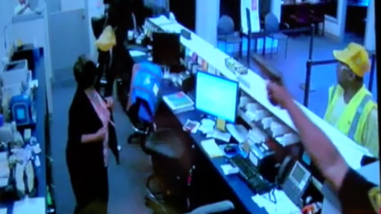 VIDEO: Officer shoots armed bank robbery suspect
