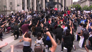 Protesters kneeing