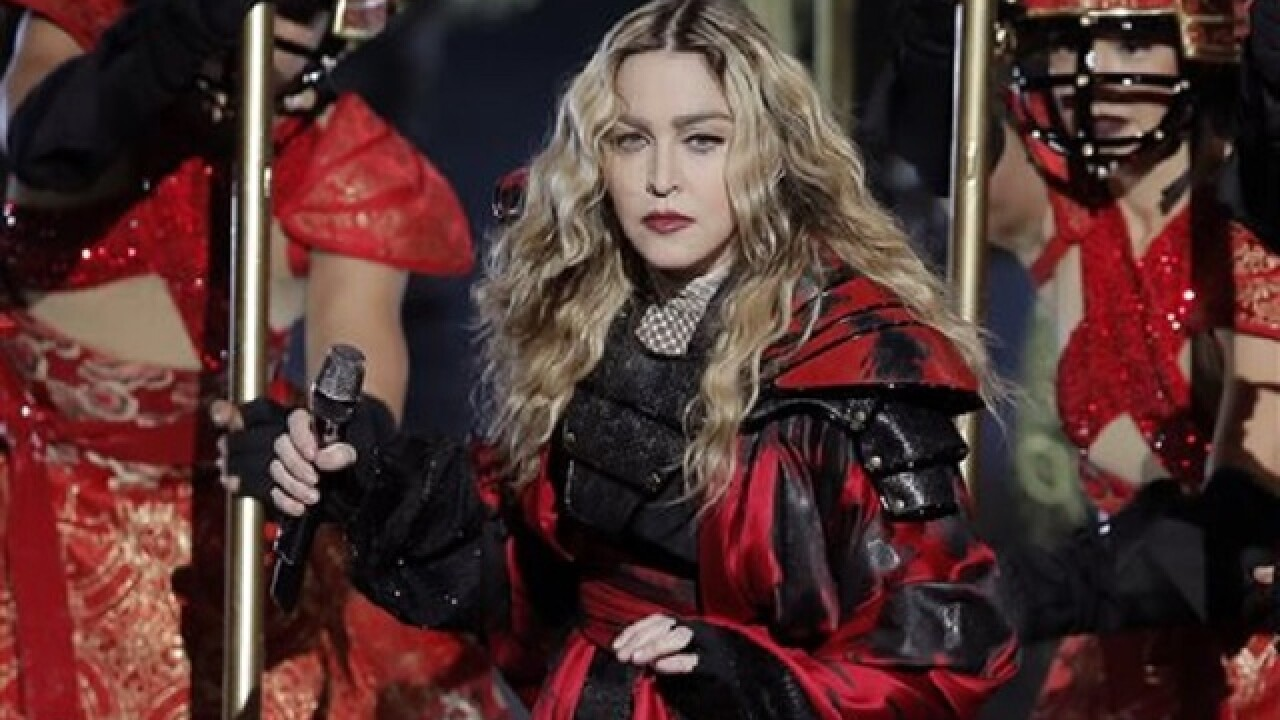 Madonna performs surprise concert for Clinton in NYC park