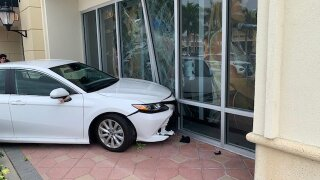A driver crashed into the front of the Guitar Center store in Port St. Lucie on Saturday.