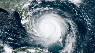 In this NOAA GOES-East satellite handout image, Hurricane Dorian, now a Cat. 4 storm, moves slowly past Grand Bahama Island on September 2, 2019 in the Atlantic Ocean. Dorian moved slowly past the Bahamas at times just 1 mph as it unleashed massive flooding and winds of 150 m.p.h.
