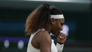 Serena Williams after falling to ground at Wimbledon in June 2021