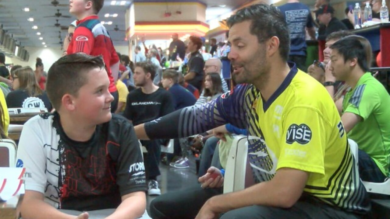 Hundreds join bowling pros in pro-am event