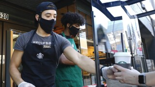 Starbucks once again offering free coffee to essential workers amid spike in COVID-19 cases