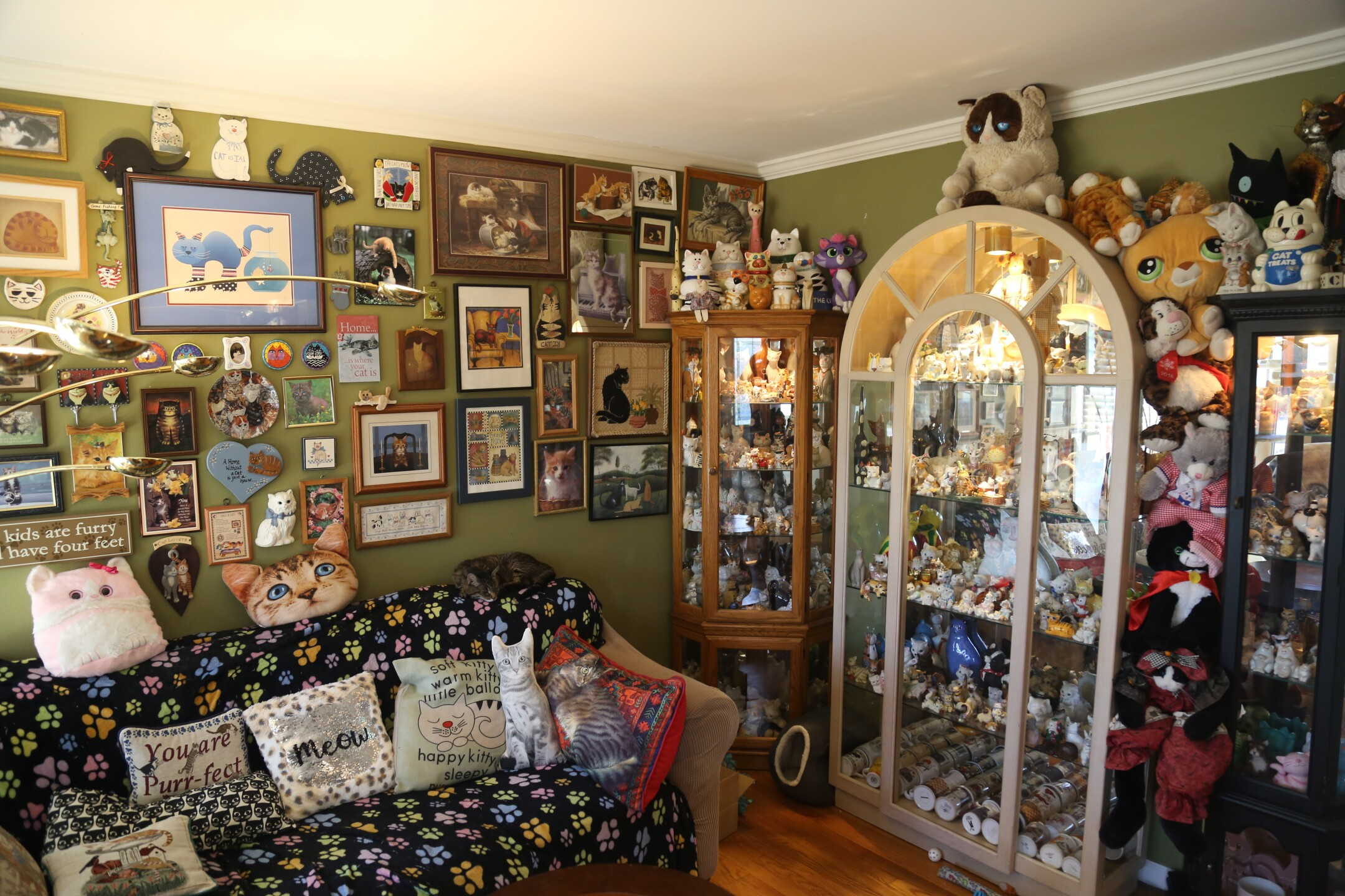 You wouldn't believe it based on how little space there is for more decorating, but the Menomonee Falls couple is still collecting art. They plan on putting it on the ceiling.