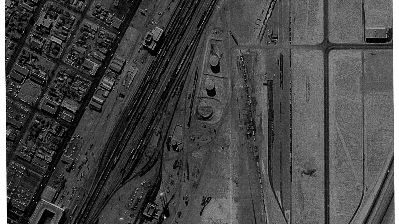 This is an aerial image from 1972 showing what would become the present day location of the Clark County Government Center. The property was used to dump oil, fuel and other chemicals used in the former railyard.