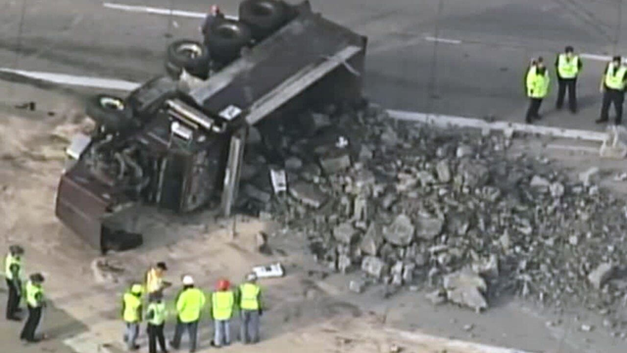 Overturned truck, diesel spill backing up traffic at I-35 at