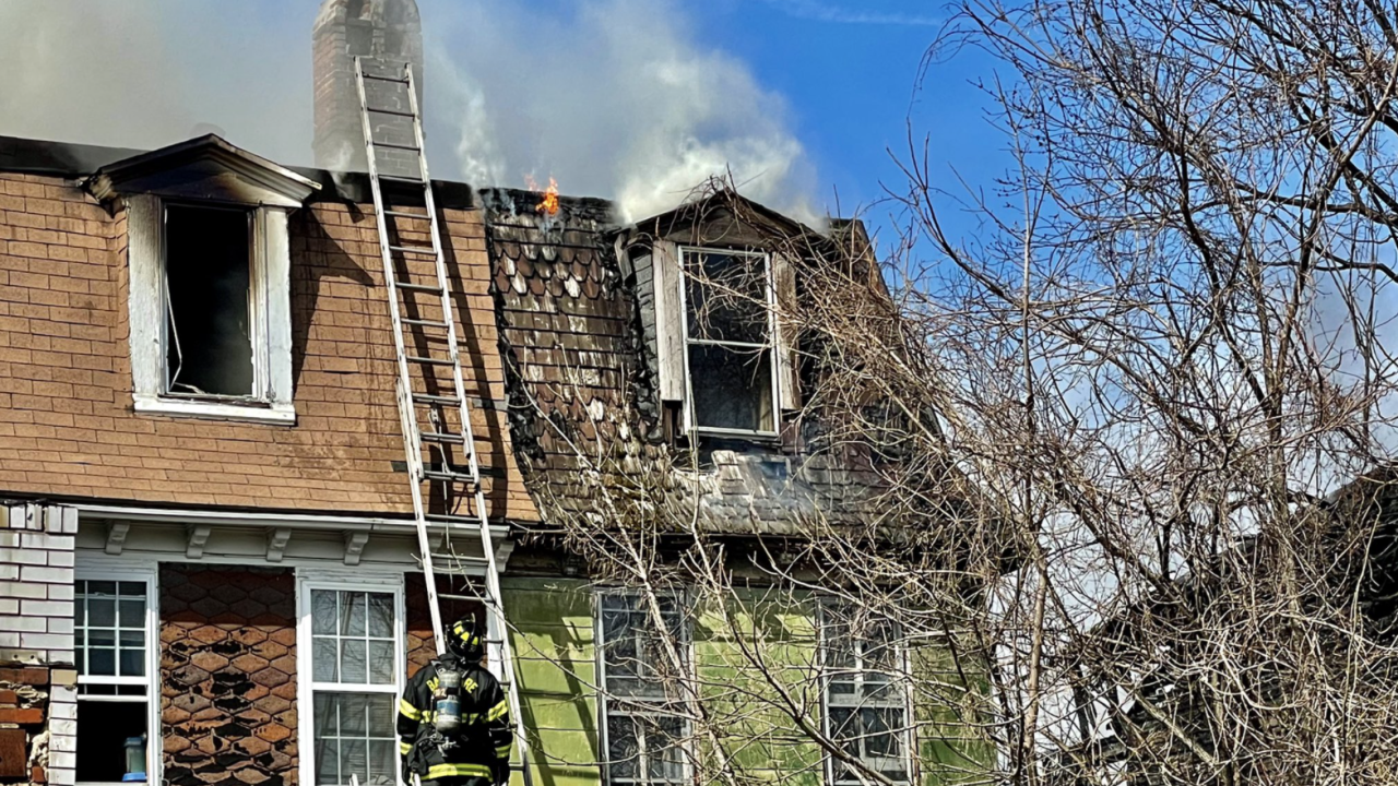 A two alarm fire spread through three Southwest Baltimore row homes on Friday