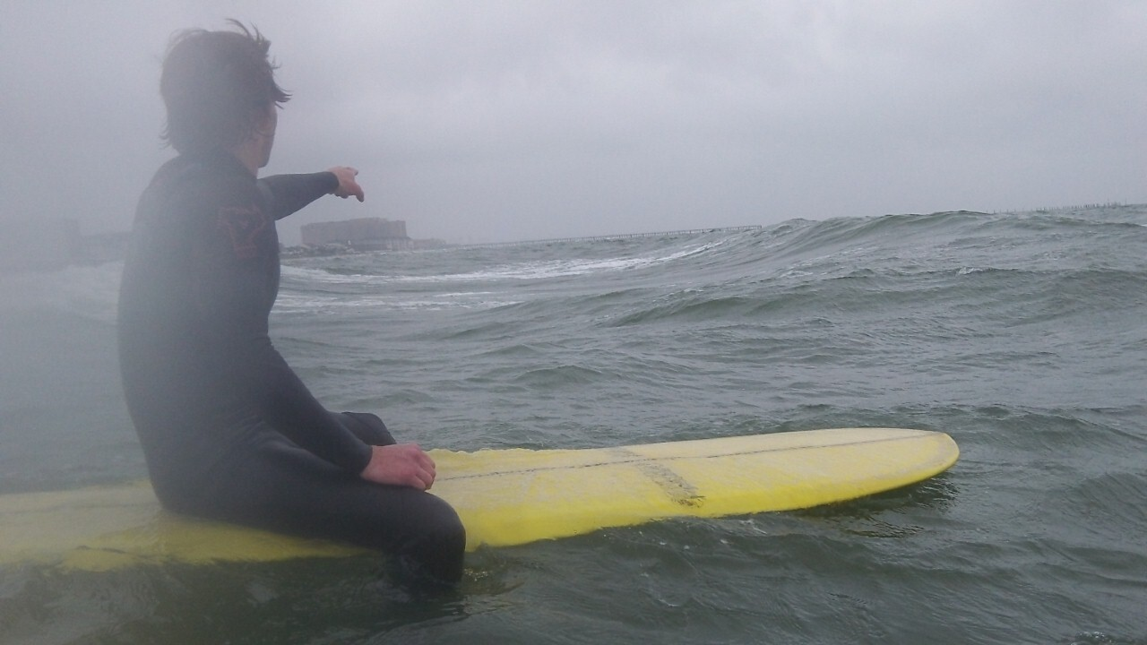 Surfers take advantage of Chesapeake Bay swell