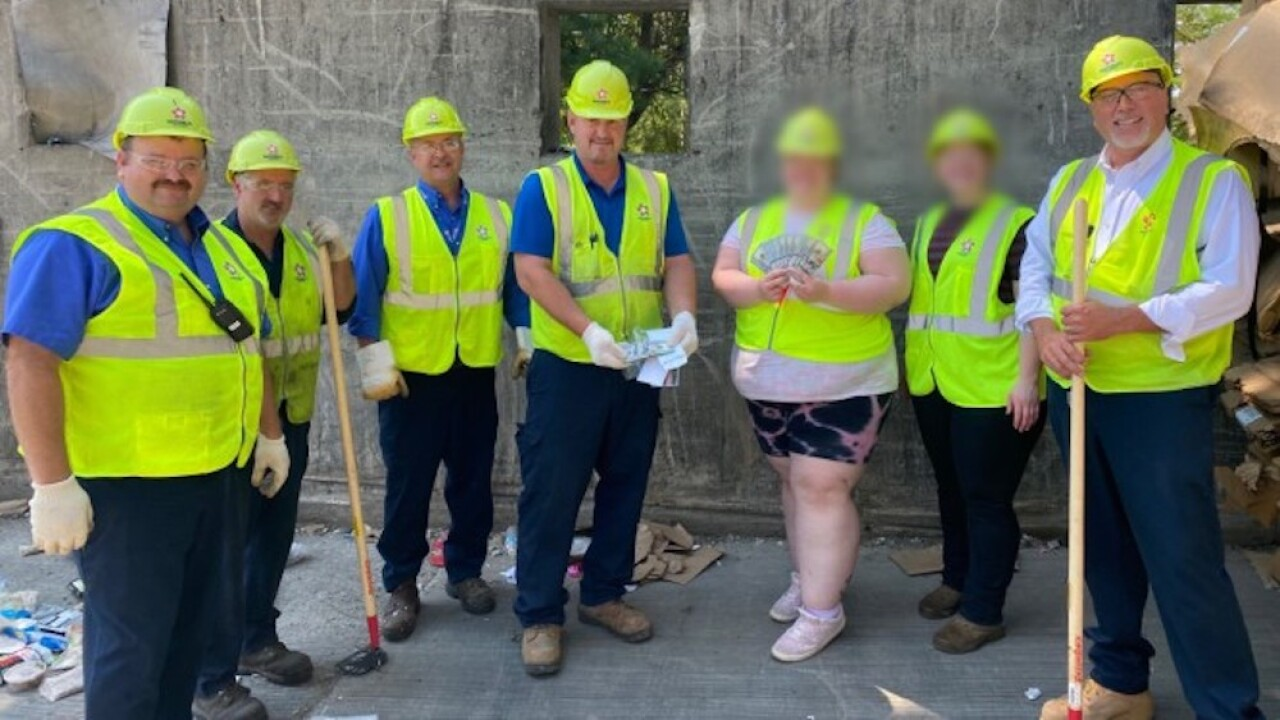 Workers find cash thrown in garbage