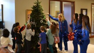 Local students light up the holidays at Zions Bank