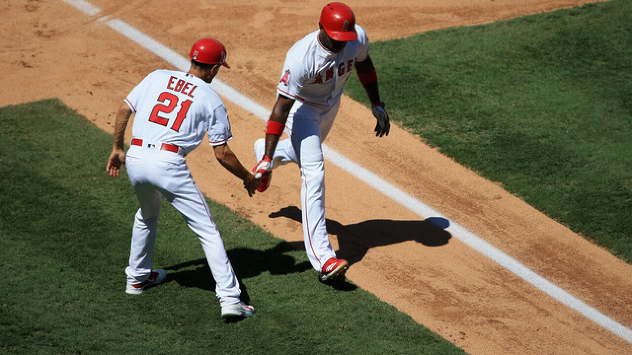 Upton, Pujols, Calhoun homer in Angels win over Tigers