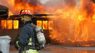 PHOTOS: Firefighters battle Ada County house fire