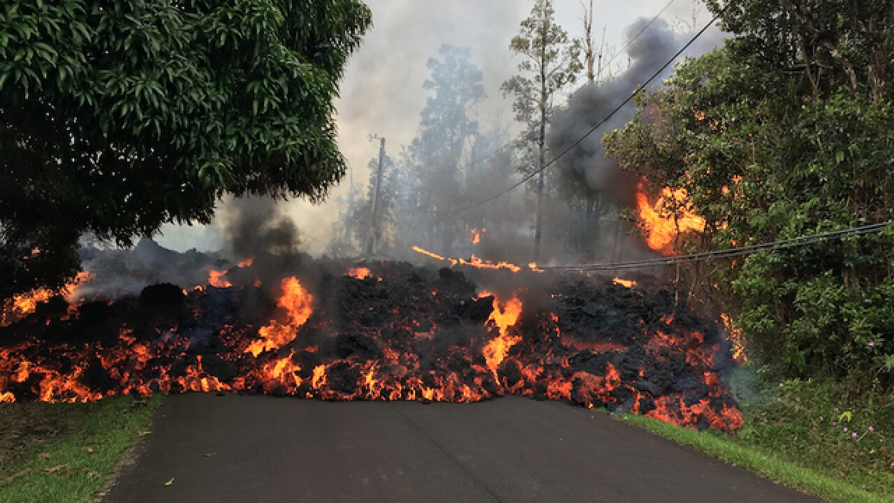 Watch: Lava from volcano moves down road in Hawaii neighborhood