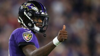 Lamar Jackson #8 of the Baltimore Ravens gives a thumbs up during the AFC Divisional Playoff game against the Tennessee Titans at M&T Bank Stadium on January 11, 2020 in Baltimore, Maryland.