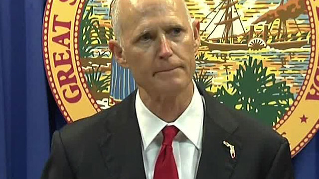 Florida governor signs bill that tightens gun control, arms more school officials