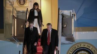 Baron Trump, Melania Trump and Donald Trump walk off Air Force One in February 2020