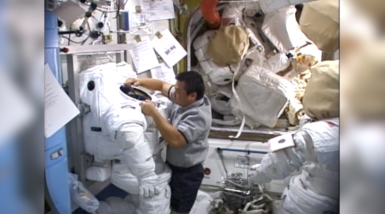 Chiao checking out space suit