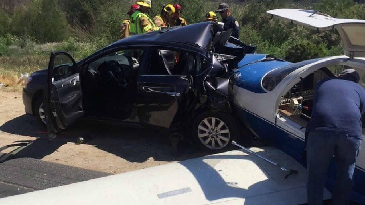 Small plane crashes into car on northbound I-15