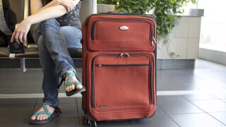 Travel- Person with suitcase