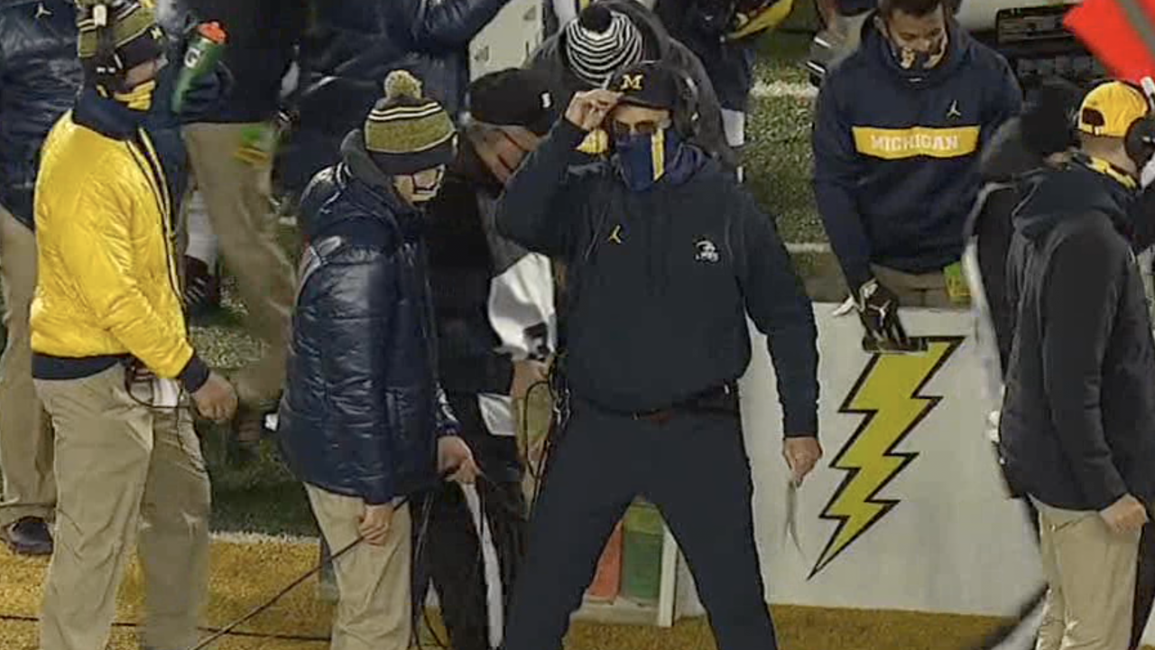 Jim Harbaugh blue pants