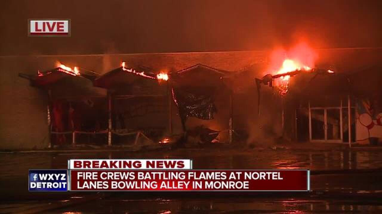 Crews fight large fire at Monroe bowling alley