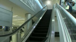 A toddler was caught in an airport escalator and fell to his death. Now his mom is charged with child abuse