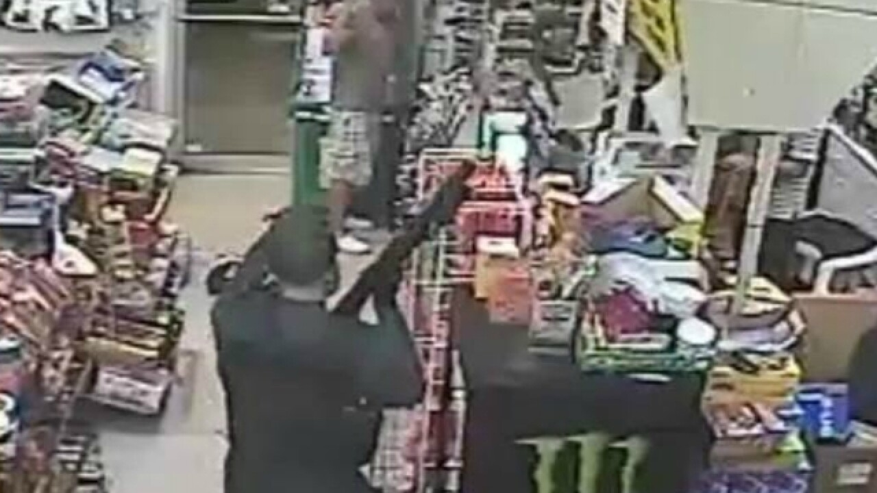 WATCH: Masked robber fires shot in grocery store