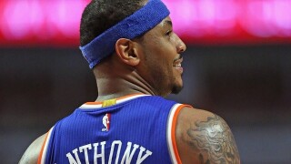 Child runs onto court, hugs Carmelo Anthony