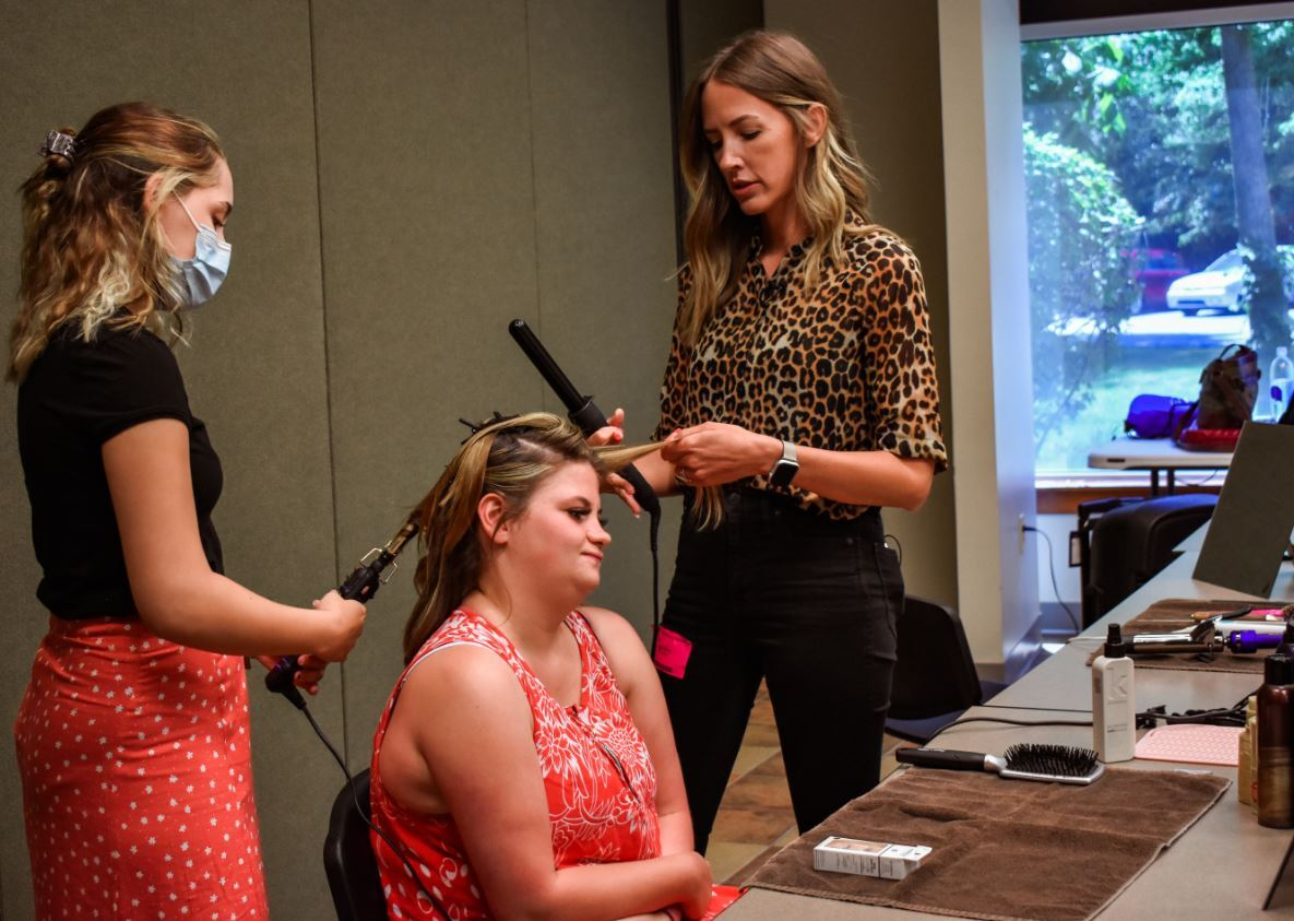 Haley Miller (l) and Lora Moore (r) doing Becca's hair.JPG