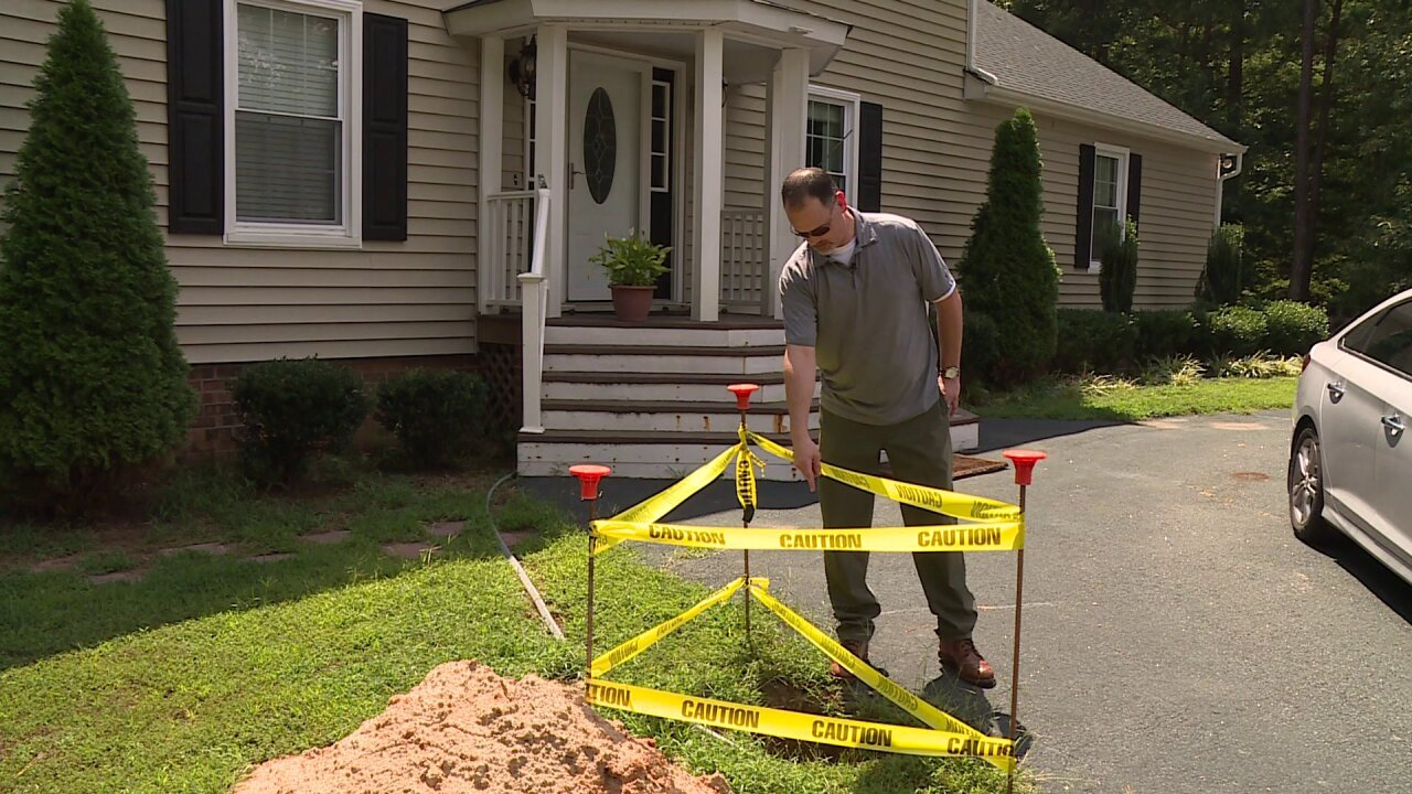 Homeowner worries of kids' safety after Dominion Energy leaves hole, exposed wires inyard