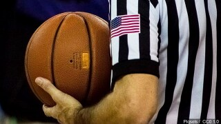 Referee holding a basketball.jpg