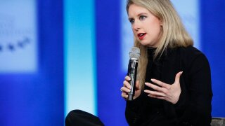 Elizabeth Holmes indicted on wire fraud charges, steps down from Theranos