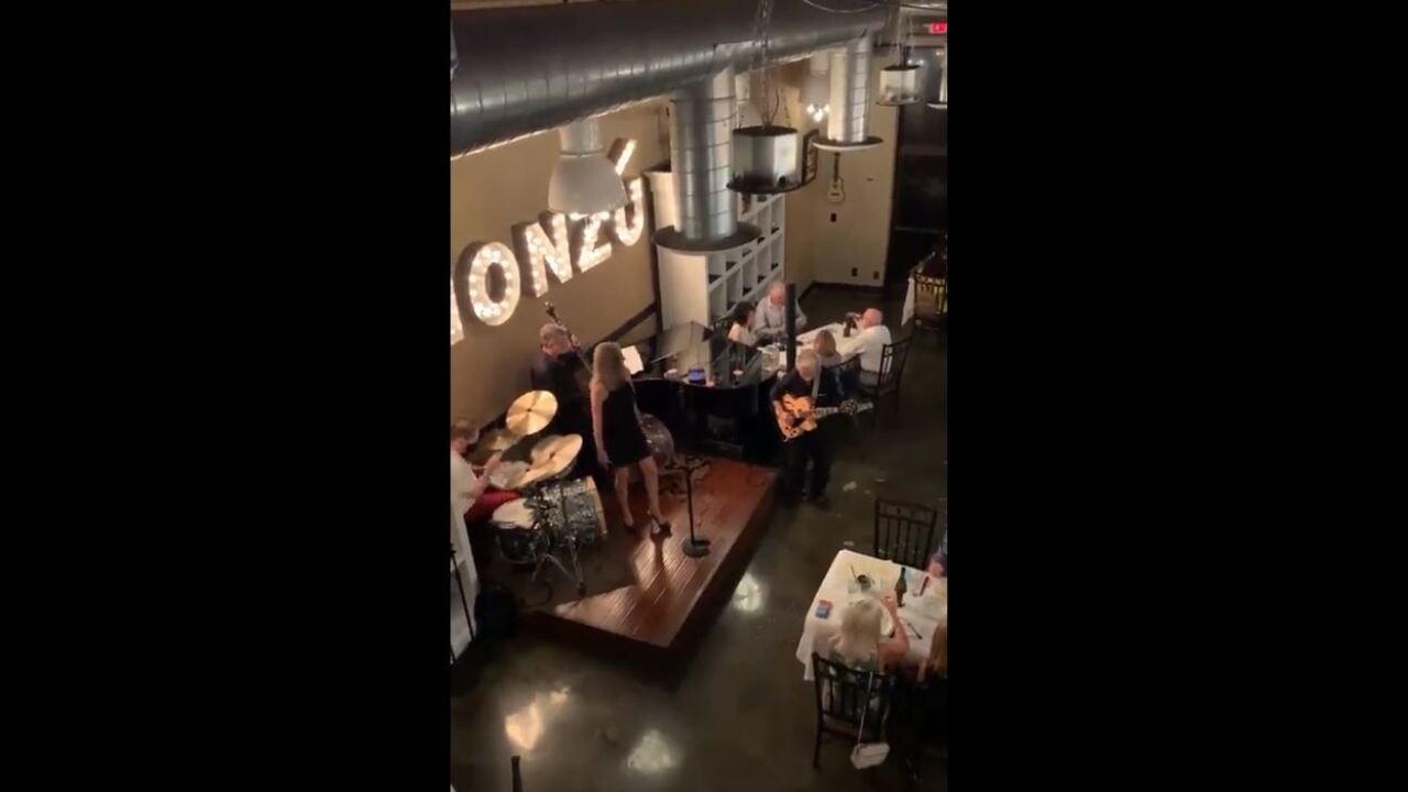 The governor is responding to a viral video in which he appears to be having dinner next to a live band despite current restrictions due to COVID-19