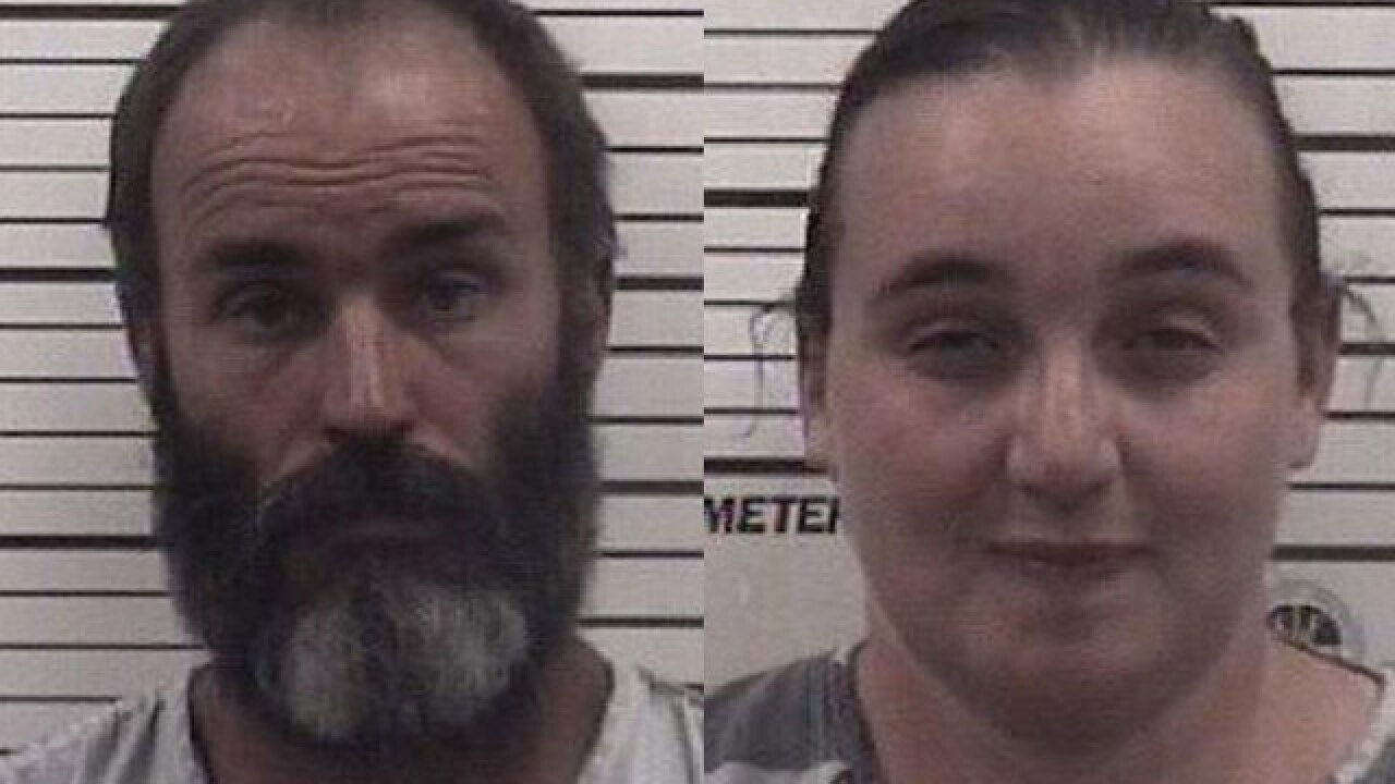 Couple accused of keeping food from sons, sitting on them
