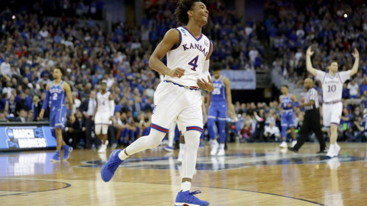 KU wins OT thriller, advances to Final Four