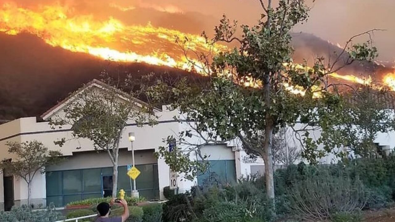 Down the road from mass shooting, people are being evacuated because of a wildfire