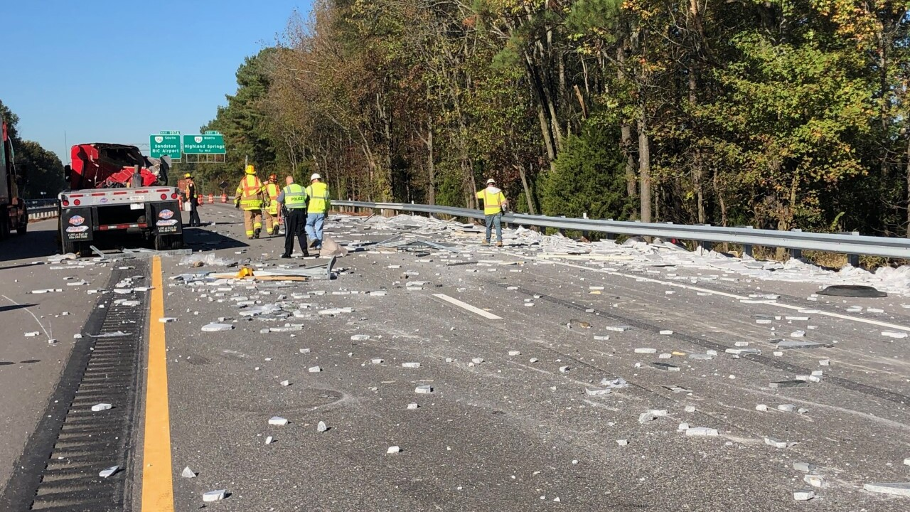 Driver charged after marble slab falls from tractor-trailer onI-64