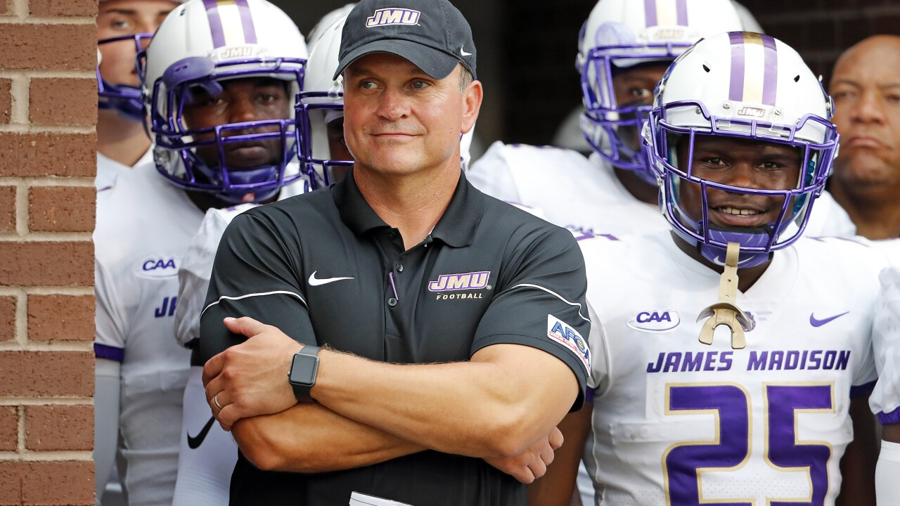 JMU head football coach Mike Houston reportedly being pursued by Charlotte and East Carolina