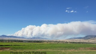McClusky fire throws up huge smoke plume, crews hope forecast rains will help efforts